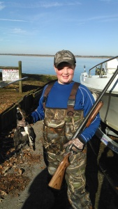 My friends son and the two ducks we shot.